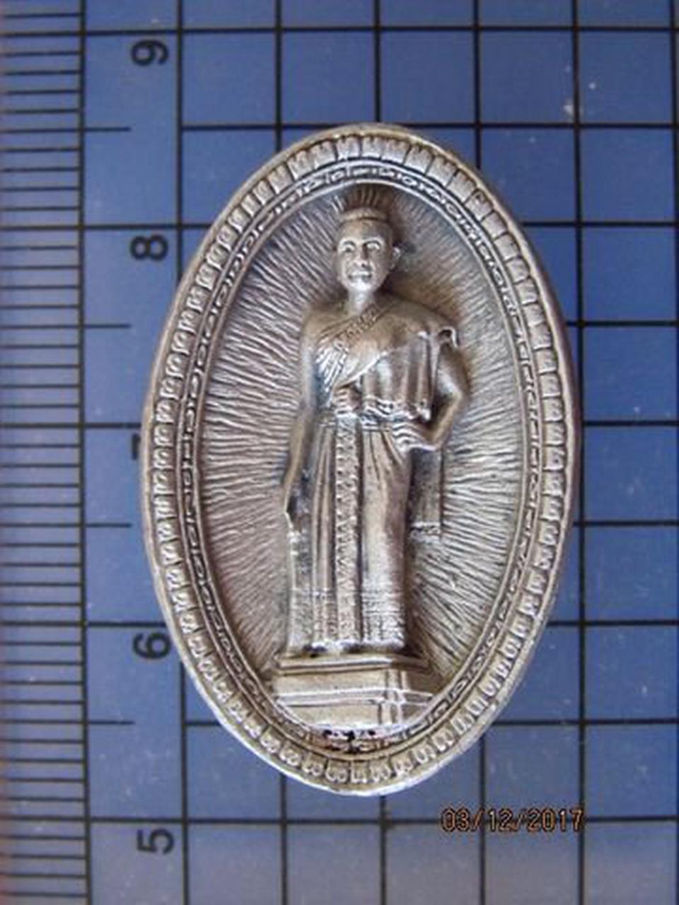 4972 เหรียญหล่อย่าโม ฉลองครบรอบ 25 ปี สโมสรไลออนส์โคราช รูปที่ 1