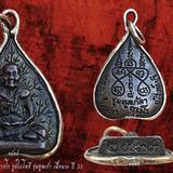 เหรียญหลวงปู่บุดดา ถาวโร รูปใบโพธิ์ รุ่นทูลเก้า เนื้อนวะ